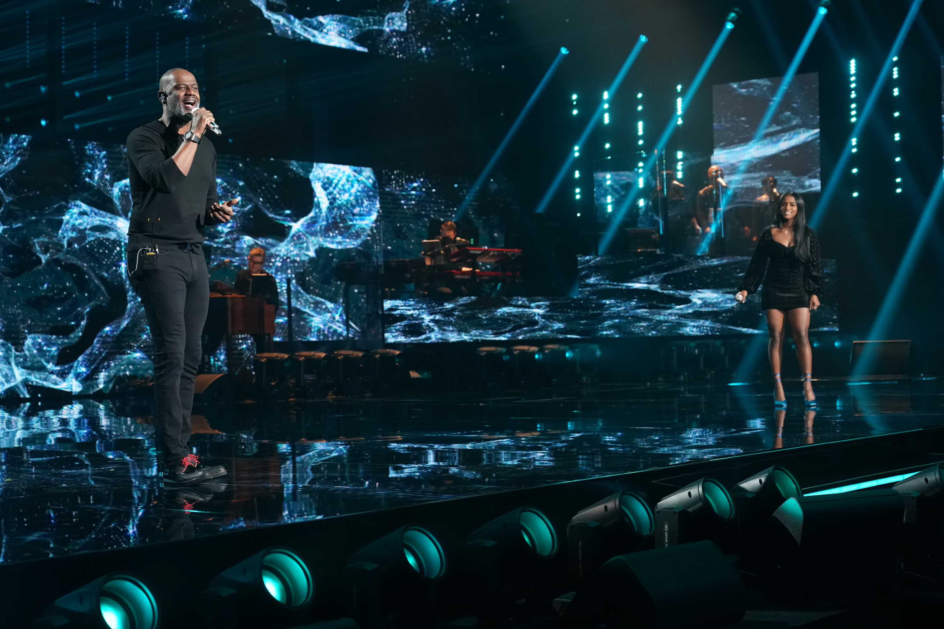 Brian McKnight performs with Top 24's Alana